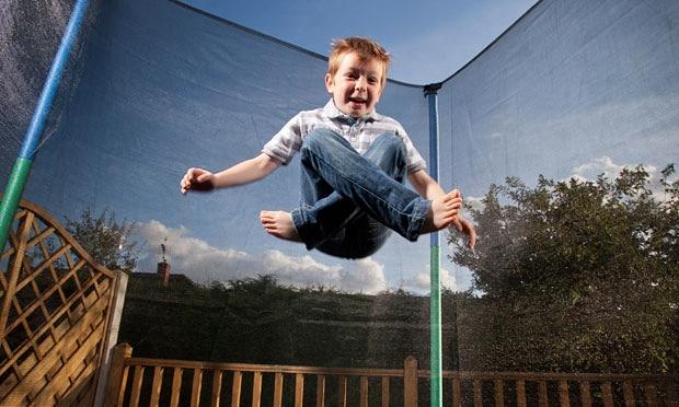 boy play on trampoline