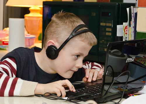 boy play computer game