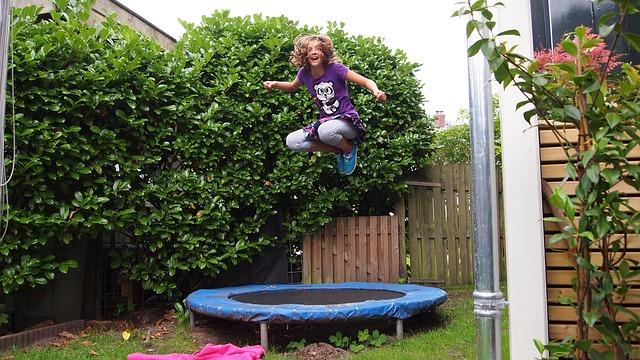 girl- play on trampoline