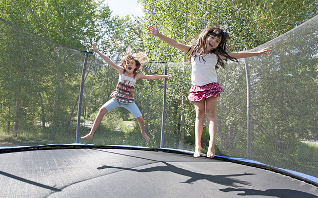 have fun with kid on trampoline