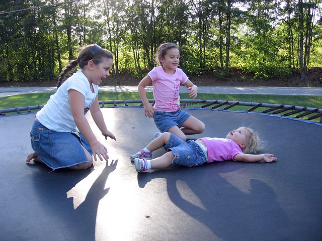 Kids on trampoline without  trampoline safety nets