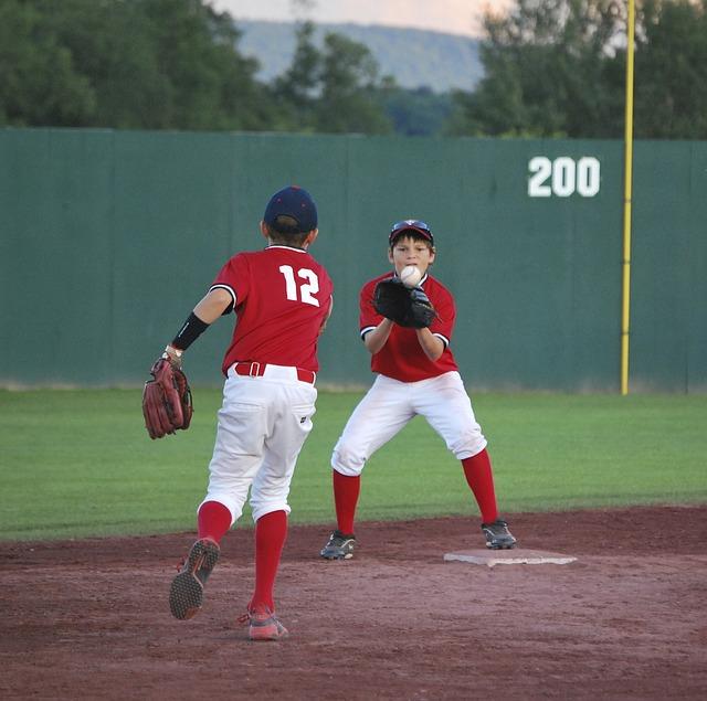 kids play baseball